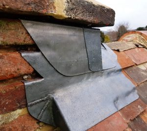 leadwork for brick and clay tile roof Surrey Sussex